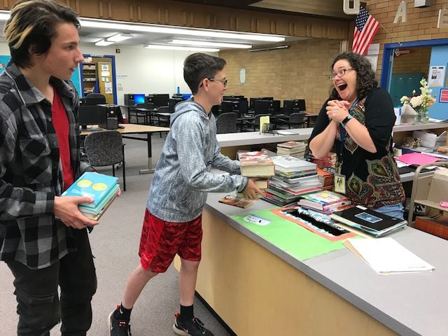 Student checking out library book